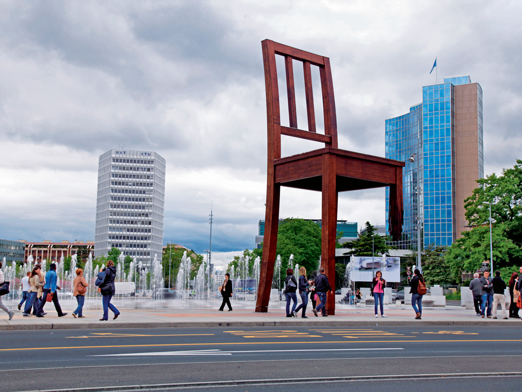 "Swiss artist Daniel Berset's ""Broken Chair"" was installed in August 1997 as an appeal to countries to sign a treaty for the banning of landmines. Photo by: Inna Felker/shutterstock"
