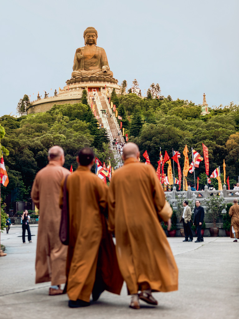 Visitors usually light yellow incense sticks at the entrance of the Po Lin Monastery, and they need to climb 268 steps to reach the foot of the seated bronze Buddha sculpture here. Photo by: Merten Snijders/Lonely Planet Images/Getty Images