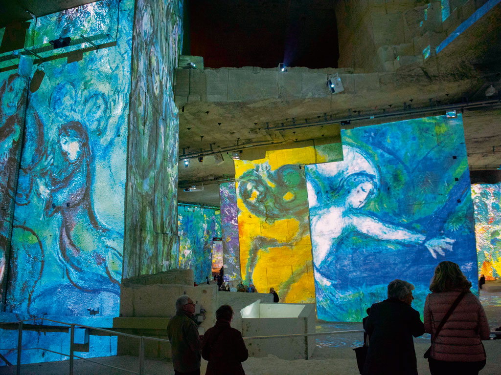 Khanna says that her kids are often exasperated by her holiday ideas. For instance, the time they visited a dramatic art show called Carrières de Lumières in France they complained about getting bored. Photo by Wolfgang Kaehler/Contributor/Lightrocket/Getty Images