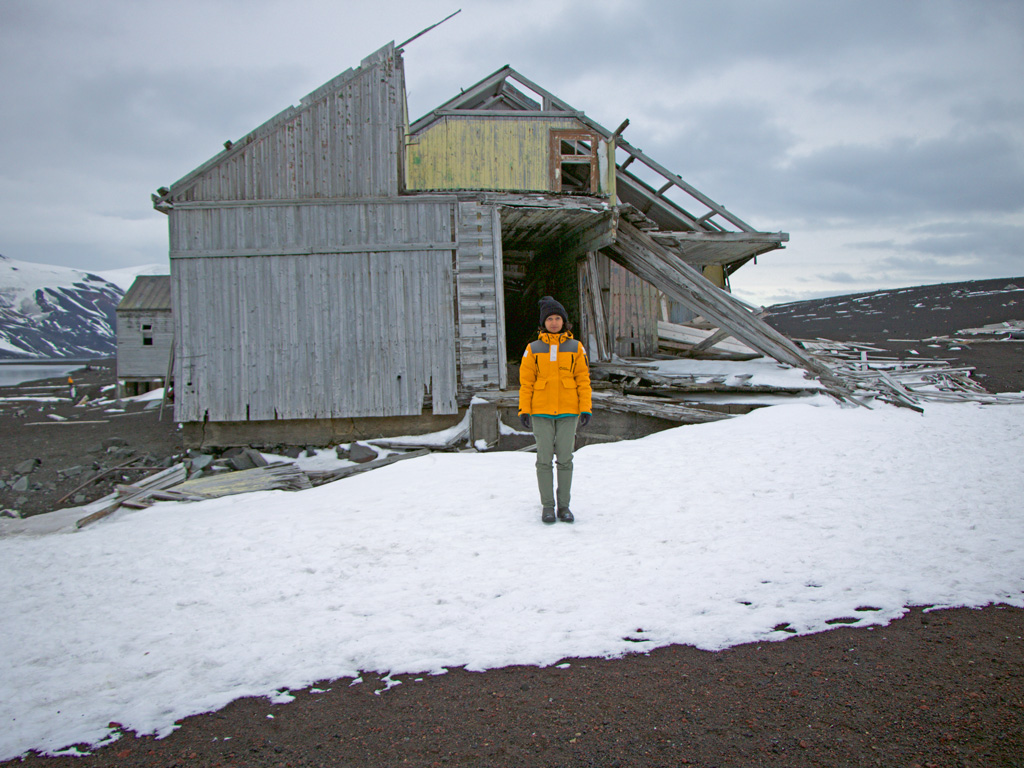 The writer at Deception Island, amid the remains of buildings and whaling equipment. Whaling began here since the early 1900s and continued till circa 1931. Photo by Himali Singh Soin.