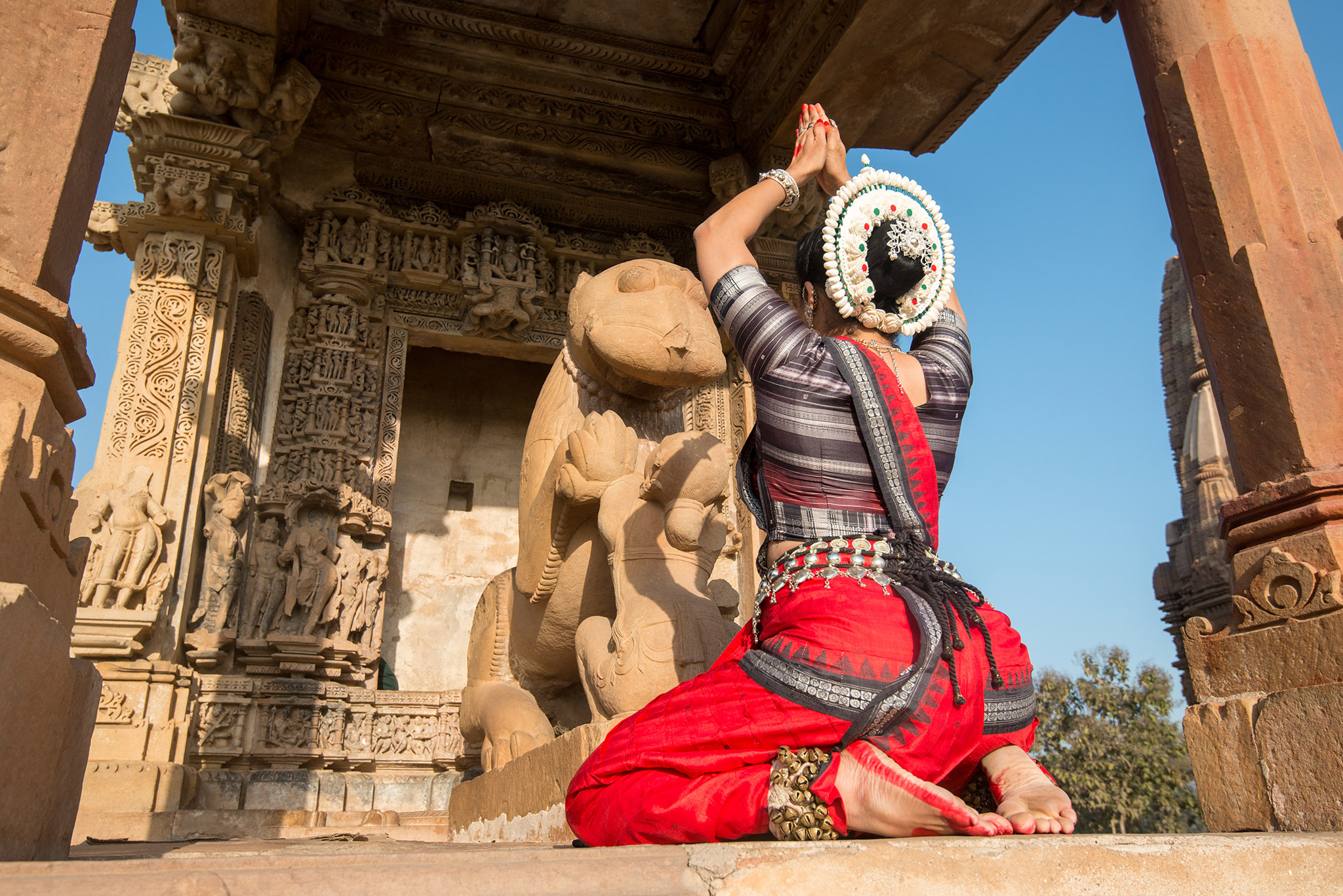 At the Khajuraho Dance Festival, colorful and brilliant Indian classical dance forms fight for attention. The dancer in the picture is a part of the Kaishiki dance troupe.