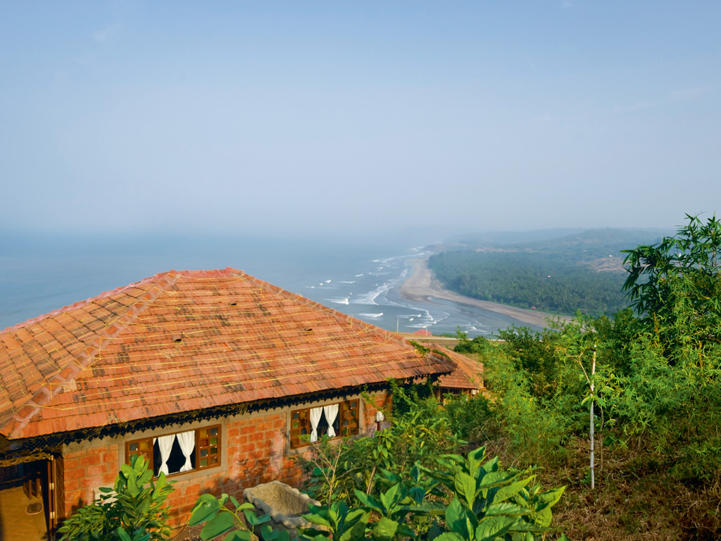 The property, which looks out over a wave-dappled coastline, is green and abundant. Photo by Saee Bhurke.