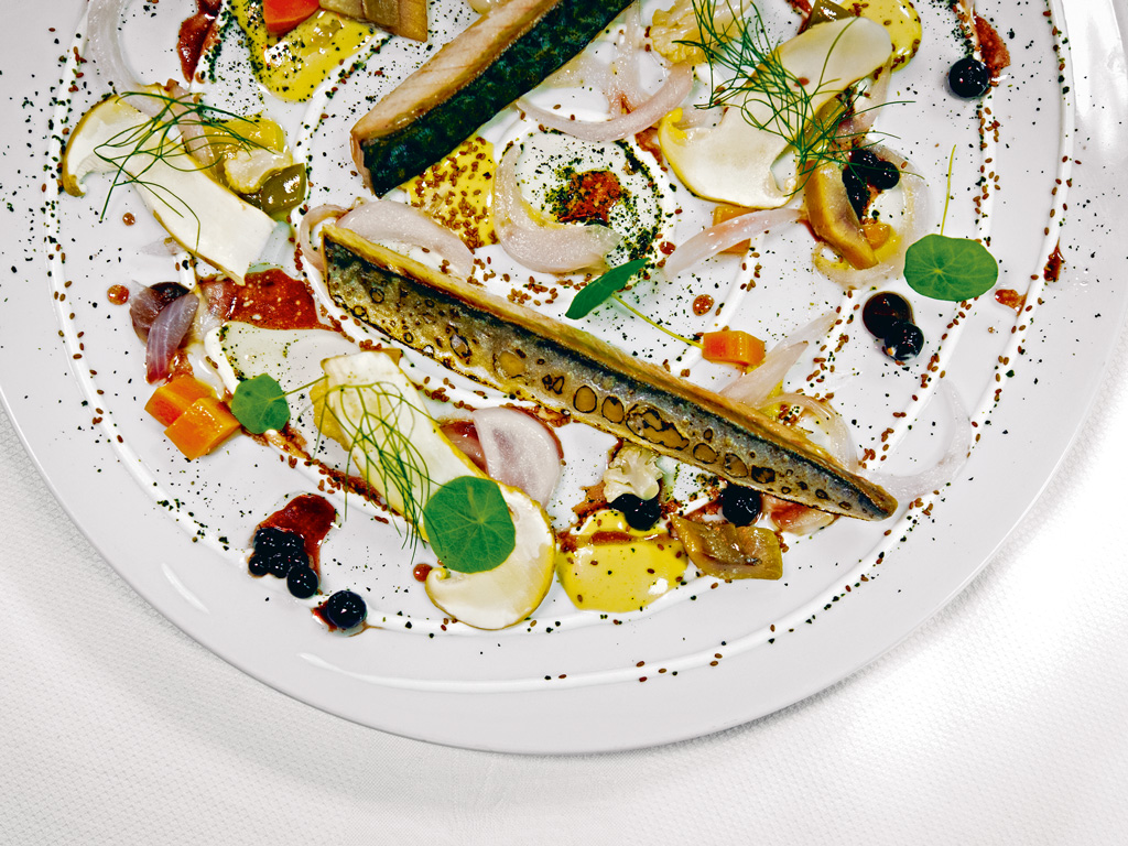 An artfully arranged dish of mackerel and foraged vegetables at Toqué. Photo by: Hans Laurendeau/shootstudio.ca