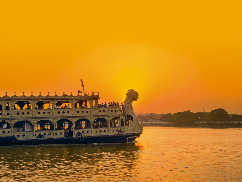 Boat tours along the Hooghly river take visitors past colonial cities that were established along the river to take advantage of shipping routes via the Bay of Bengal. Copyright by Siripong Kaewlaiad/Moment/Getty Images