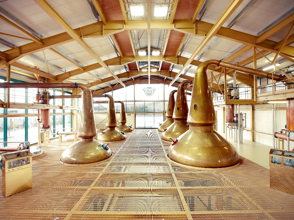 The copper stills, originally designed by George Smith, are unique to The Glenlivet. Their design encourages maximum contact with the purifying copper and ensures only the lightest vapours reach the top to condense and become 'low wines,' with an alcohol content of approximately 20-22 per cent. Photo courtesy: The Glenlivet Distillery